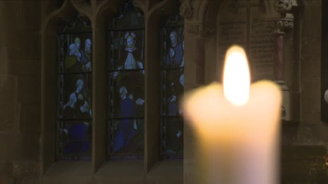 candle burning in a church - chapel stock videos & royalty-free footage