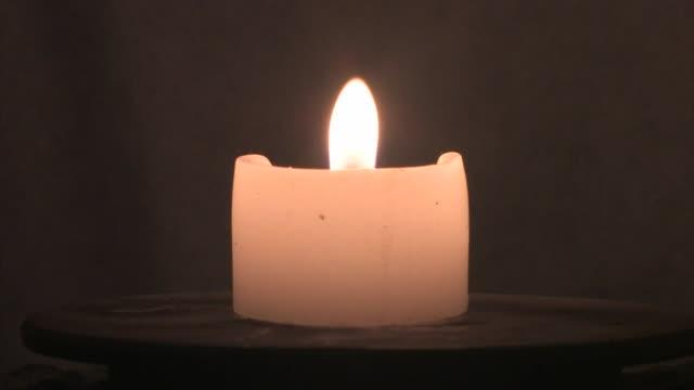 candle burning in a stone lantern, nara prefecture, japan - lantern stock videos & royalty-free footage