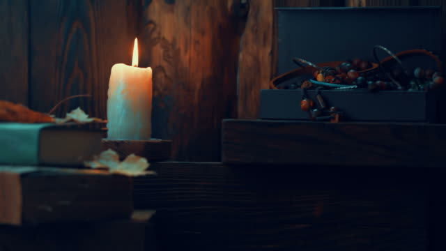 candle burning on wooden shelf - jewelry box stock videos and b-roll footage