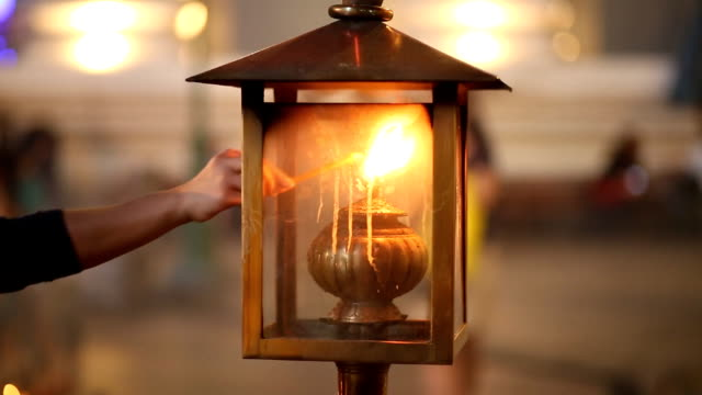 candle burning with oil lantern - electric lamp stock videos & royalty-free footage