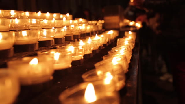candle christian for pray and hope - church stock videos & royalty-free footage