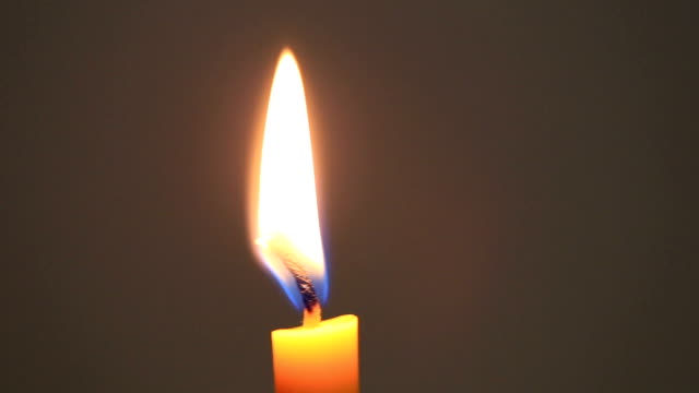 Candle flame of Burning on wall background.
