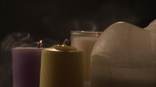 candle flames extinguish. - släcka bildbanksvideor och videomaterial från bakom kulisserna