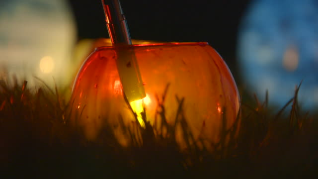 candle holder glows orange - candlelight stock videos & royalty-free footage