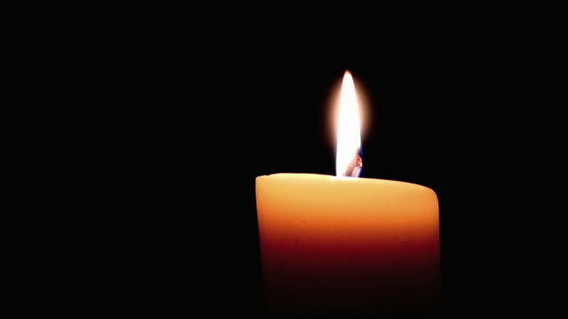 candle in blackness - candle stock videos and b-roll footage