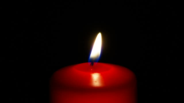candle in red seamless loop ntsc 24p ful hd - votive candle stock videos and b-roll footage