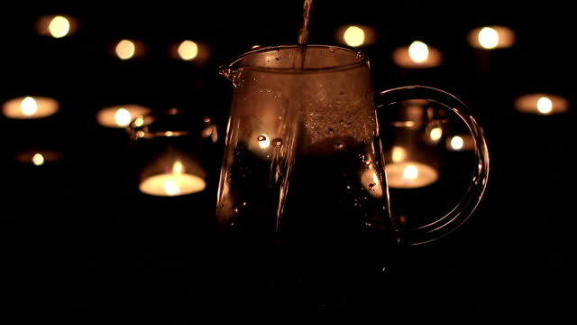 candle light and water