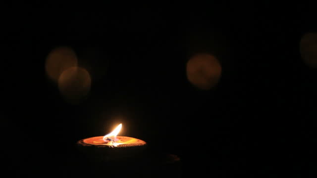 candle light at night - christmas decore candle stock videos & royalty-free footage