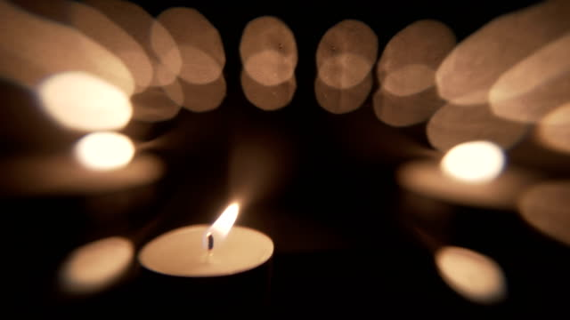 candle light backdrop background - tea light stock videos and b-roll footage