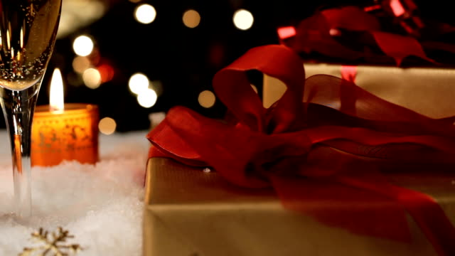 candle lights wine and presents - christmas gift stock videos & royalty-free footage