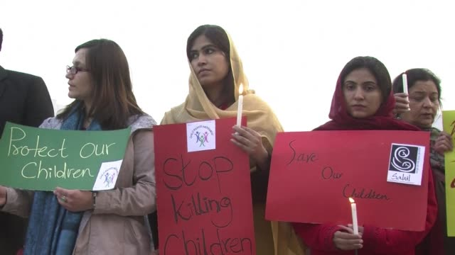 candle lit vigil was held in islamabad thursday after 148 people including 132 children were massacred by the pakistani taliban at a school in... - peshawar stock videos & royalty-free footage