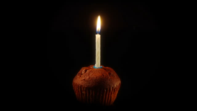 candle on a cake - time lapse ntsc 24p - candle stock videos & royalty-free footage