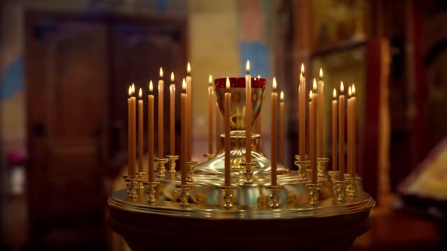 candle on candlestick holder in church - vertigo zoom fx - chapel stock videos & royalty-free footage