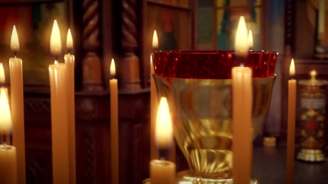 candle on candlestick holder in church - christianity stock videos & royalty-free footage