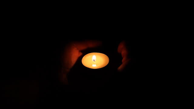 Candle on palm