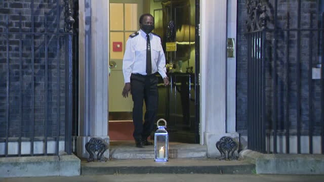 candle put outside 10 downing street, as lights shine in memory of all those who have lost their lives from coronavirus, one year on from the first... - shiny stock videos & royalty-free footage