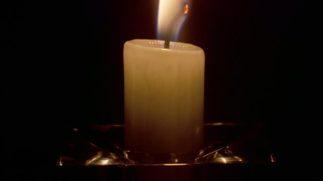 A candle shrinks as it burns, then goes out.