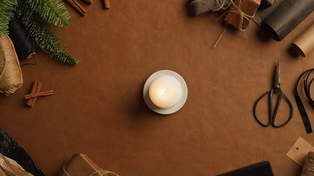 candle surrounded by wrapping paper and craft equipment - northern europe stock videos & royalty-free footage