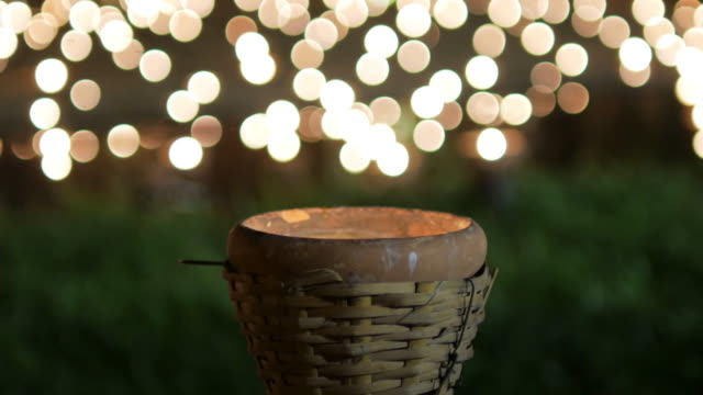 Candle with circle light bokeh for background footage design