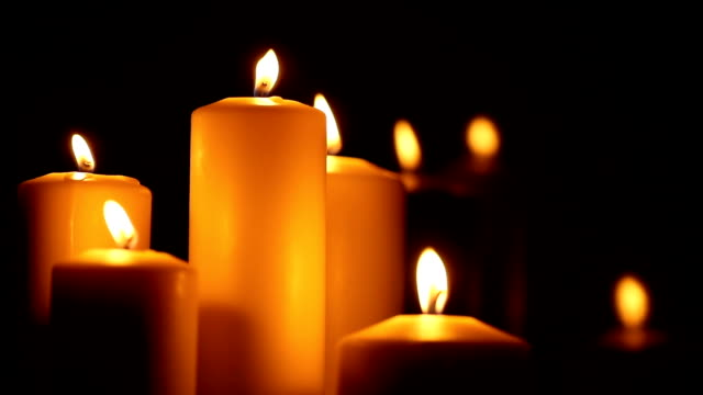 candled burning in the night - candlelight stock videos and b-roll footage