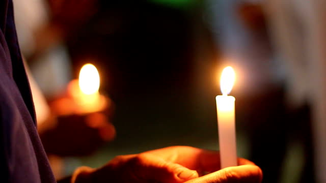 candlelight and remembrance ceremony - candle stock videos and b-roll footage