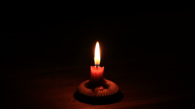 Candlelight in dark room.