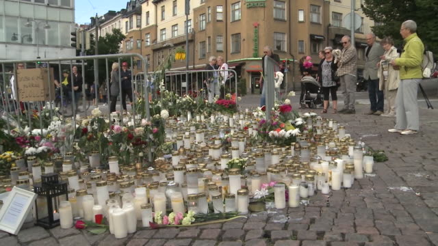 stockvideo's en b-roll-footage met a candlelight tribute in turku finland after two women were killed in a suspected terror attack - terrorisme