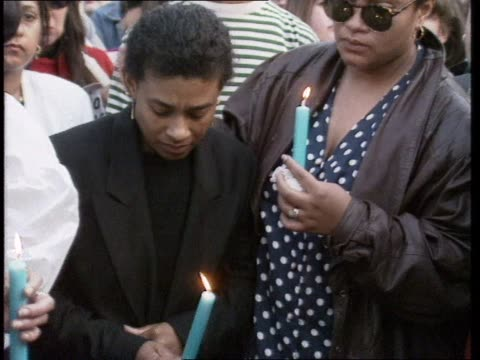 vídeos y material grabado en eventos de stock de a candlelight vigil at the location that stabbed 18 year old stephen lawrence staggered to before dying in eltham - 1993