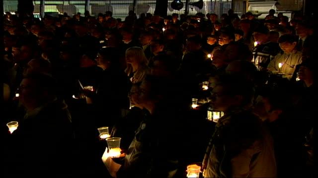 candlelight vigil held for gay murder victim david morley; england: london: soho: ext/night male choir singing at memorial vigil for murdered gay man... - murder victim stock videos & royalty-free footage