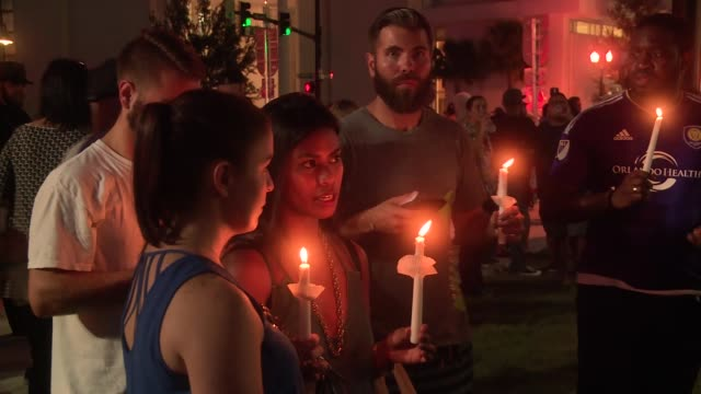 candlelight vigil held for victims of shooting at pulse nightclub orlando - candlelight stock videos & royalty-free footage