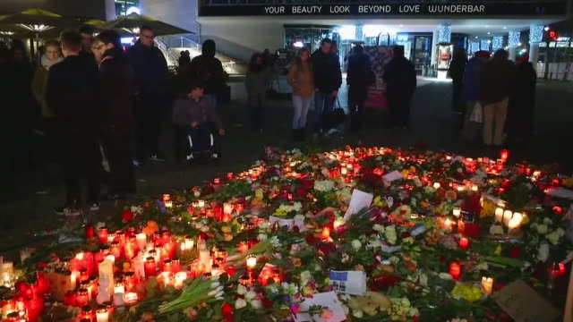 a candlelight vigil in berlin in remembrance of the victims of the lorry terror attack - 仮設追悼施設点の映像素材/bロール