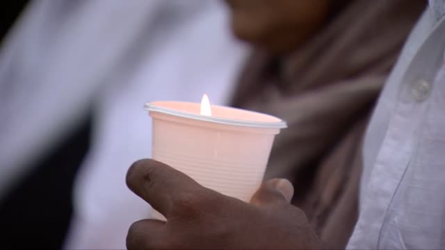 a candlelight vigil taking place in colombo for victims of the sri lanka terror attacks - trauernder stock-videos und b-roll-filmmaterial