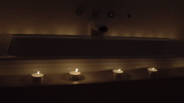 a candle-lit bathtub - igniting stock videos & royalty-free footage