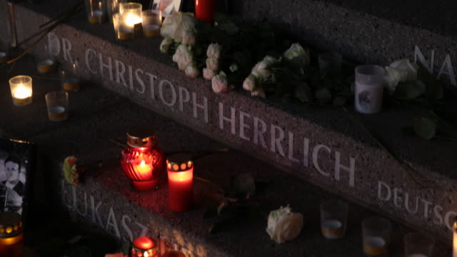 candles and flowers lay at the inscription to polish victim lukasz urban, the truck driver killed by terrorist anis amri for his truck and dr.... - terrorism stock videos & royalty-free footage