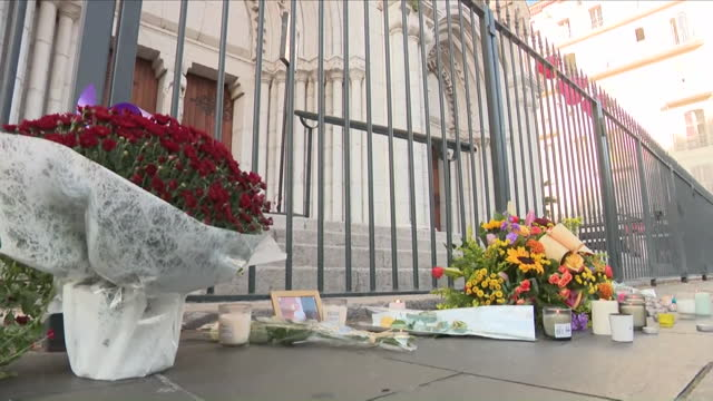 candles and flowers left outside the notre-dame basilica after a deadly terrorist attack - basilica stock videos & royalty-free footage