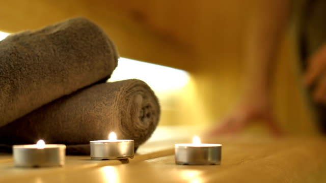 candles and towels close up shot in sauna - spa treatment stock videos & royalty-free footage