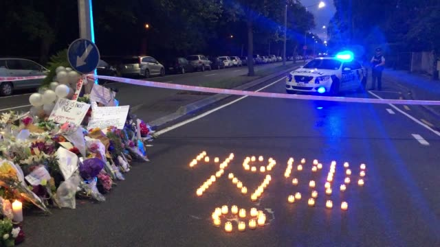 candles at the memorial of flowers left on deans rd near the al noor mosque march 17 2019 in christchurch new zealand 50 people are confirmed dead... - christchurch stock-videos und b-roll-filmmaterial