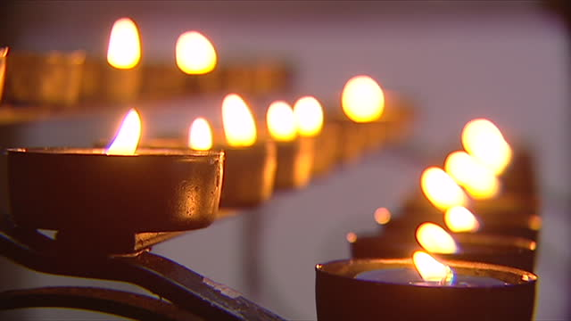 candles being lit inside a church - candlelight stock videos & royalty-free footage
