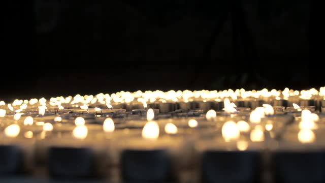 candles being lit to represent the 100,000 people who have now died from coronavirus in the uk - candle stock videos & royalty-free footage