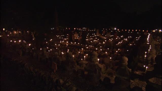 vidéos et rushes de candles burn for spirits of dead at sentokuyo candle offering, adashinonenbutsuji temple - souvenirs