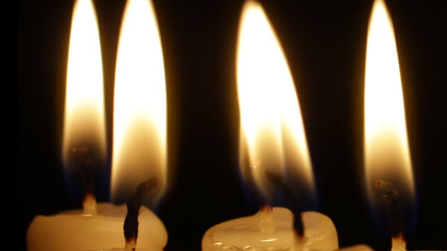 candles burning and flickering - medium group of objects stock videos & royalty-free footage