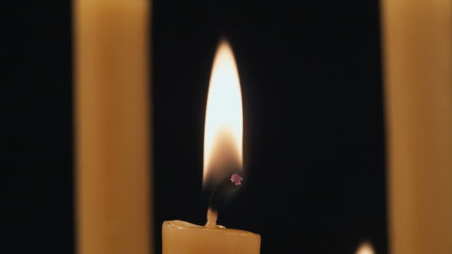 ecu td candles burning / auckland, new zealand - ローソク点の映像素材/bロール