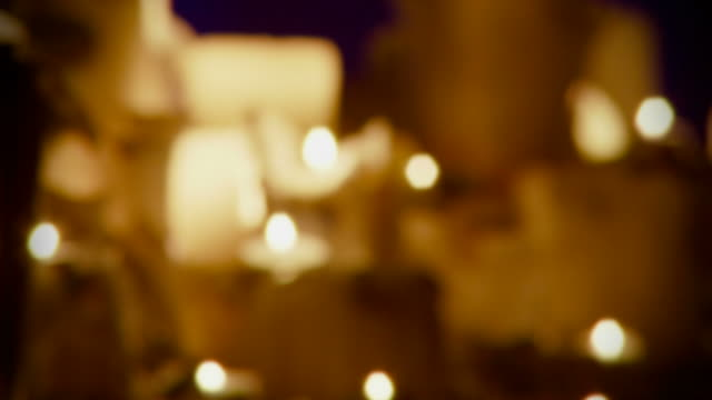 candles defocused seamless loop - full hd - candle stock videos & royalty-free footage