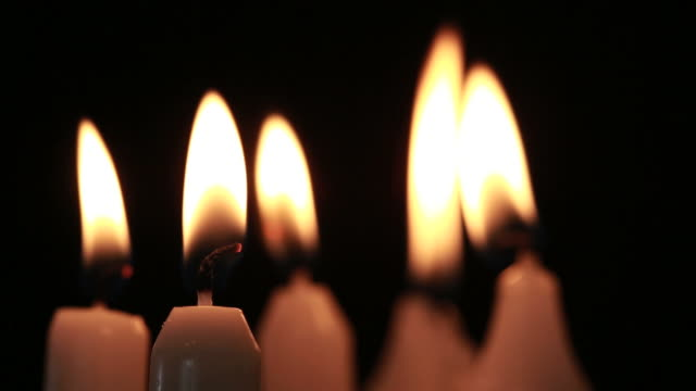 candles flickering in the breeze - candle stock videos & royalty-free footage
