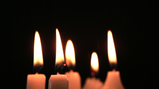 candles flickering - candlelight stock videos and b-roll footage