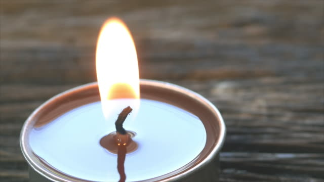 4k candles for relaxation on wood table. - massage stock videos & royalty-free footage