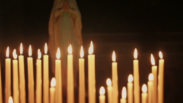 Candles in a church and the Virgin Mary