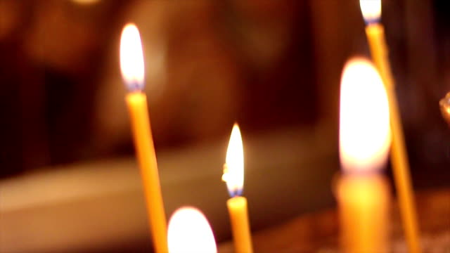 candles in church - eastern european culture stock videos and b-roll footage