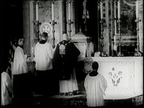 candles in front of crucifix / priest at altar / flagdraped casket / - attentat auf john f. kennedy stock-videos und b-roll-filmmaterial