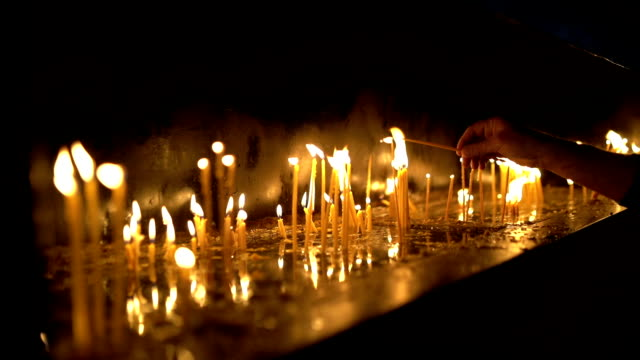 candles in the church stock video - candlelight stock videos & royalty-free footage